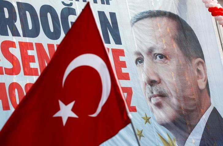 A huge banner with a picture of Turkish President Tayyip Erdogan is seen on a building during a ceremony in Istanbul, Turkey, March 26, 2017. REUTERS/Murad Sezer/Files