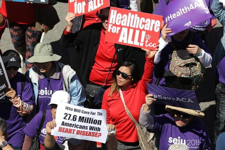 People march in a ''Save Obamacare'' rally in Los Angeles.   REUTERS/Lucy Nicholson