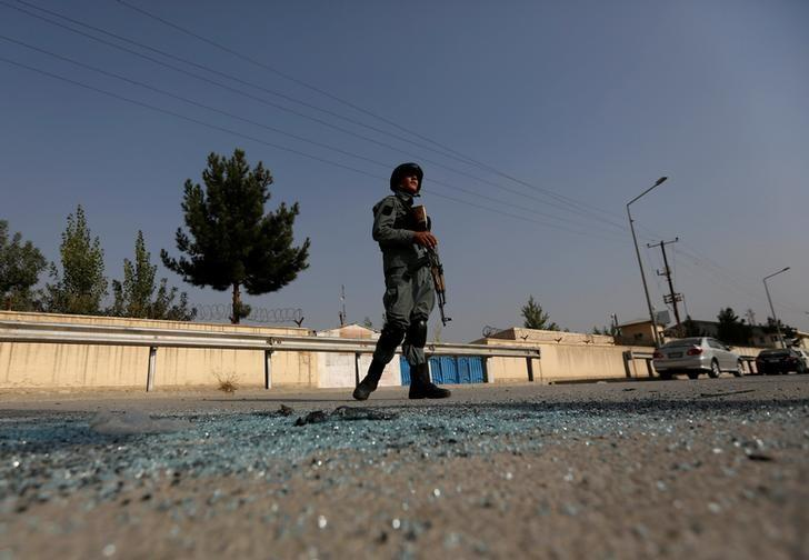 An Afghan policeman stands guard after an attack at the American University of Afghanistan in Kabul, Afghanistan  August 25, 2016. REUTERS/Mohammad Ismail/Files