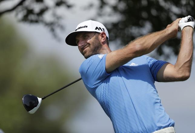 3月27日、男子ゴルフの世界ランク1位、ダスティン・ジョンソンは、ヒューストン・オープン(3月30日開幕)を欠場するという。米テキサス州オースティンで26日撮影(2017年 ロイター/Erich Schlegel-USA TODAY Sports)