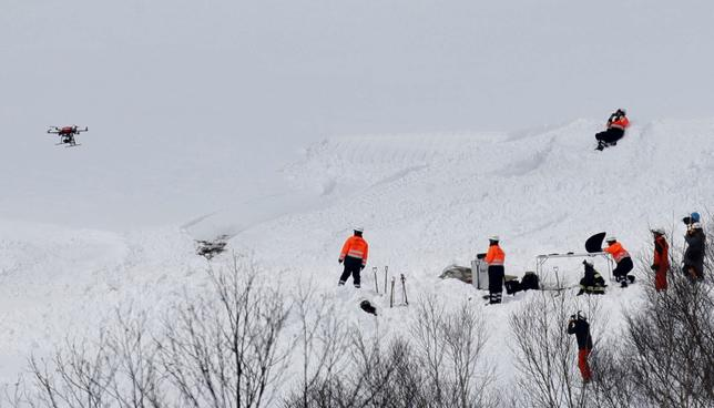 Firefighters and rescue workers using a drone investigate at the site of an avalanche in Nasu town, north of Tokyo, Japan, in this photo taken by Kyodo March 28, 2017.  Mandatory credit Kyodo/via REUTERS