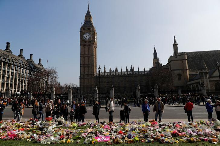 Floral tributes lie in Parliament Square following the attack in Westminster, central London, Britain March 27, 2017. REUTERS/Stefan Wermuth