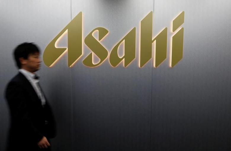A man walks past the logo of Asahi Group Holdings at the company's headquarters in Tokyo, Japan, May 17, 2016.  REUTERS/Toru Hanai