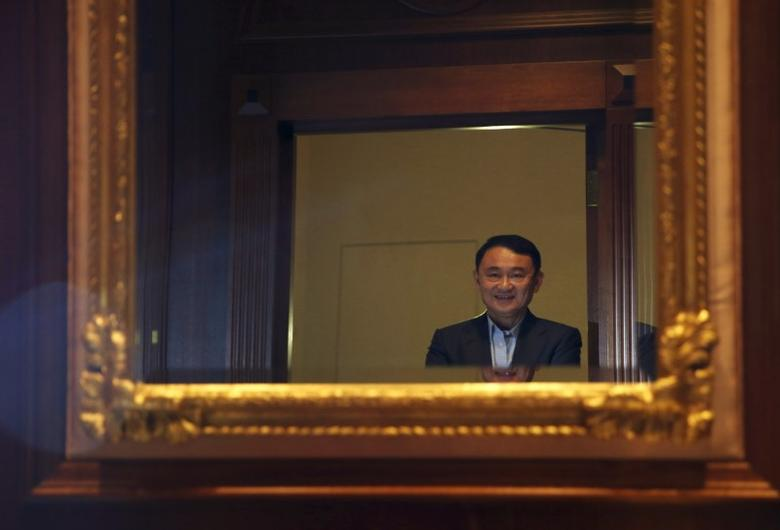 Former Thai Prime Minister Thaksin Shinawatra poses after an interview with Reuters in Singapore February 23, 2016. REUTERS/Edgar Su