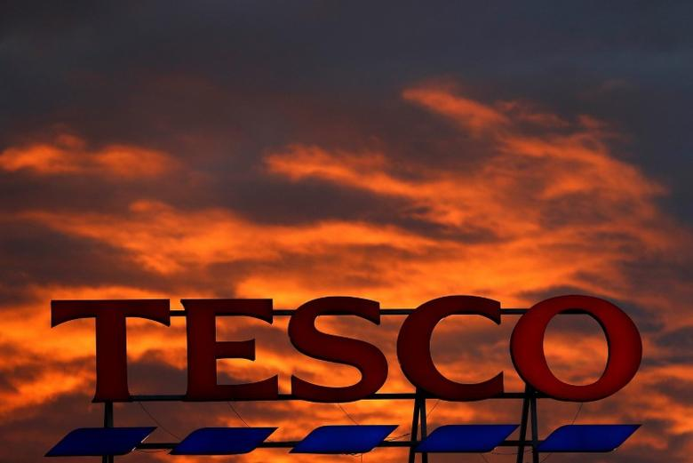 A company logo is pictured outside a Tesco  supermarket in Altrincham northern England, April 16, 2016. REUTERS/Phil Noble