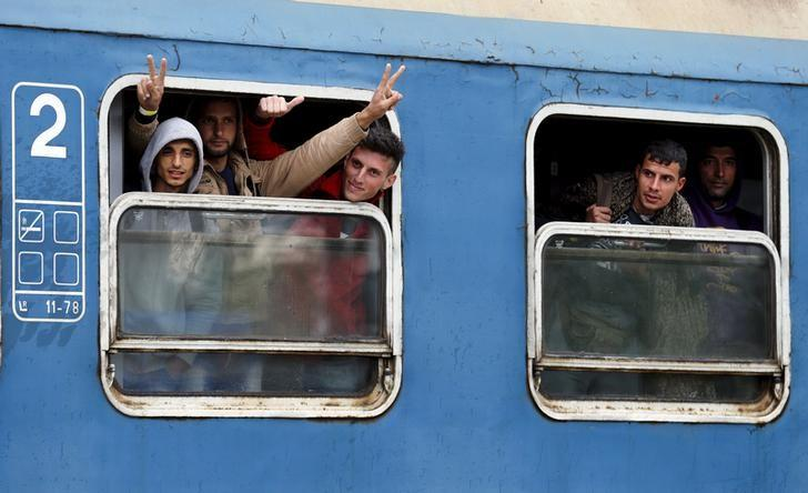 Migrants look out of a train as they arrive at the railway station at the border crossing with Austria in Hegyeshalom, Hungary, September 26, 2015. REUTERS/Heinz-Peter Bader/Files