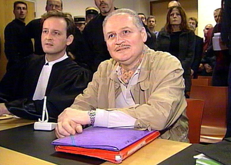 FILE PHOTO: Ilich Ramirez Sanchez, better known as ''Carlos the Jackal'' (R) seated next to his lawyer Francis Vuillemin (L) in court in Paris, France November 28, 2000. REUTERS/RTV/Thierry Chiarello/File Photo
