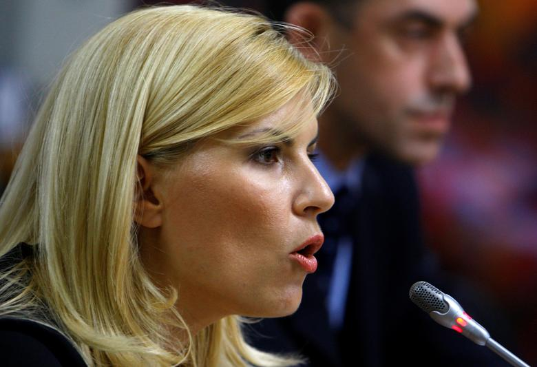 Romania's Tourism Minister Elena Udrea speaks in front of a parliamentary commission at Romania's Parliament palace in Bucharest, Romania, August 20, 2009.  REUTERS/Bogdan Cristel/Files