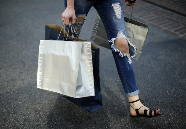 A woman carries Nordstrom shopping bags at The Grove mall in Los Angeles November 26, 2013. REUTERS/Lucy Nicholson/Files