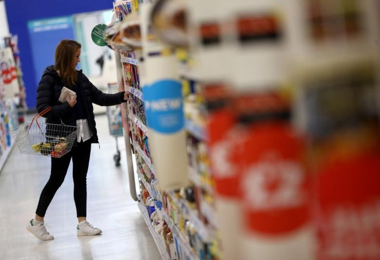 FILE PHOTO -  A woman shops at a Sainsbury's store in London, Britain October 11, 2016. REUTERS/Neil Hall/File Photo                     GLOBAL BUSINESS WEEK AHEAD PACKAGE - SEARCH BUSINESS WEEK AHEAD 16 JANUARY  FOR ALL IMAGES - RTSVNWH