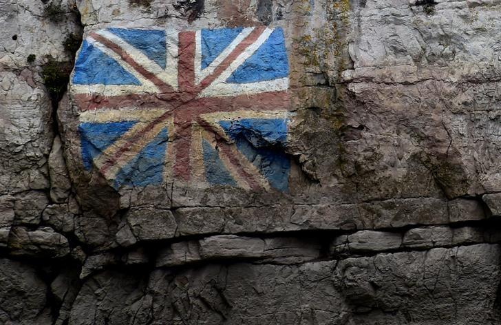 A painted Union Flag, popularly known as the Union Jack, the national flag of the United Kingdom is seen on the rocks on the English side of the River Wye, Chepstow, Wales, March 28, 2017. REUTERS/Rebecca Naden