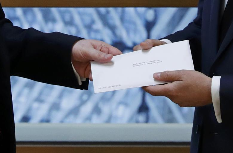 Britain's permanent representative to the European Union Tim Barrow delivers British Prime Minister Theresa May's Brexit letter in notice of the UK's intention to leave the bloc under Article 50 of the EU's Lisbon Treaty to EU Council President Donald Tusk in Brussels, Belgium March 29, 2017.   REUTERS/Yves Herman