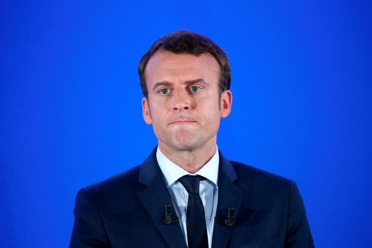 Emmanuel Macron, head of the political movement En Marche !, or Onwards !, and candidate for the 2017 French presidential election, attends a news conference at his campaign headquarters in Paris, France, March 28, 2017. REUTERS/Charles Platiau