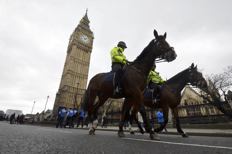 Police on horseback patrol near Westminster Bridge in London, Britain March 29, 2017. REUTERS/Hannah McKay