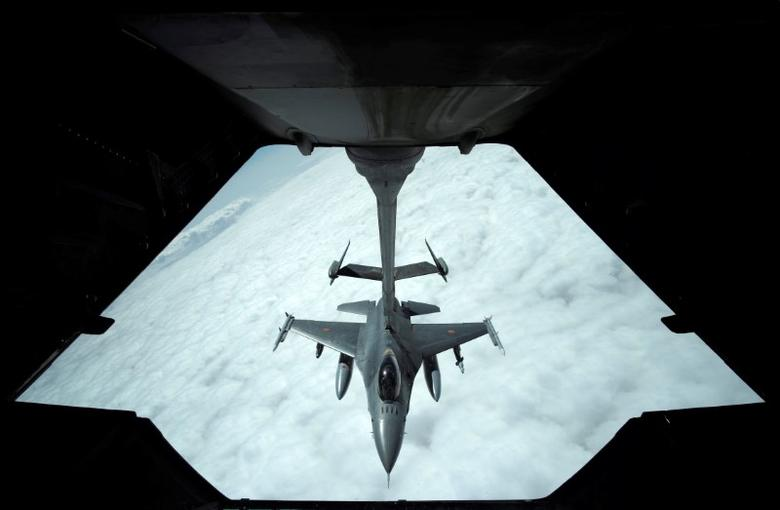 A US Air Force F-16 receives fuel from a fuel boom suspended from a US Air Force KC-10 Extender during mid-air refueling support to Operation Inherent Resolve over Iraq and Syria air space, March 15, 2017. REUTERS/Hamad I Mohammed