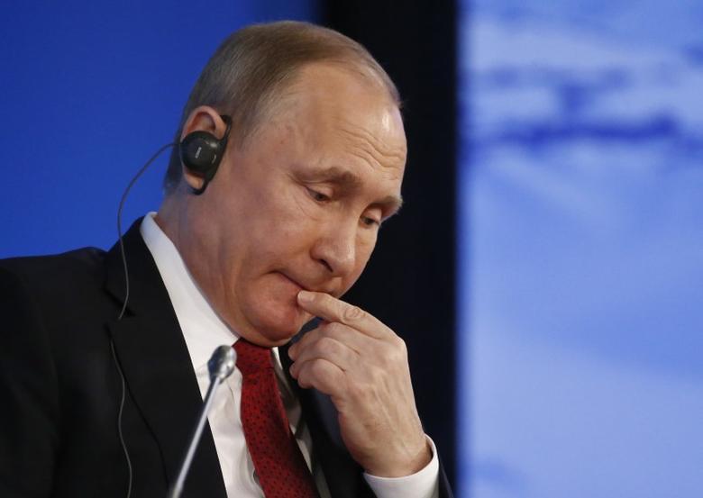 Russian President Vladimir Putin attends a session of the International Arctic Forum in Arkhangelsk, Russia March 30, 2017. REUTERS/Sergei Karpukhin