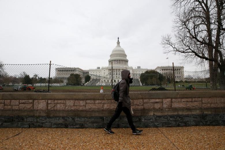 A pedestrian walks past the U.S. Capitol building , on Capitol Hill in Washington, U.S., March 24, 2017. REUTERS/Jim Bourg