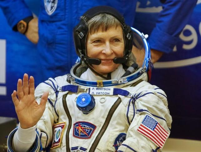 The International Space Station (ISS) crew member Peggy Whitson of the U.S., waves before a space suit check at the Baikonur cosmodrome, Kazakhstan, November 17, 2016.  REUTERS/Shamil Zhumatov