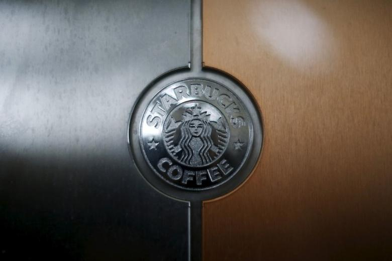 A Starbucks logo is seen on an espresso machine in a store inside the Tom Bradley terminal at LAX airport in Los Angeles, California, United States, October 27, 2015. REUTERS/Lucy Nicholson