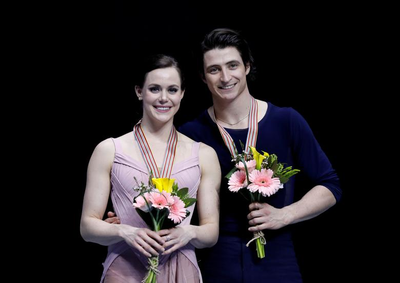 FILE PHOTO:  Figure Skating - ISU Four Continents Figure Skating Championships 2017 - Ice Dance Free Dance - Gangneung, South Korea, 17/2/17 - Gold medallists Tessa Virtue and Scott Moir of Canada attend the ceremony. REUTERS/Kim Hong-Ji/File Photo