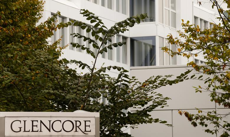 FILE PHOTO: The logo of commodities trader Glencore is pictured in front of the company's headquarters in Baar, Switzerland, September 30, 2015.  REUTERS/Arnd Wiegmann/File Photo