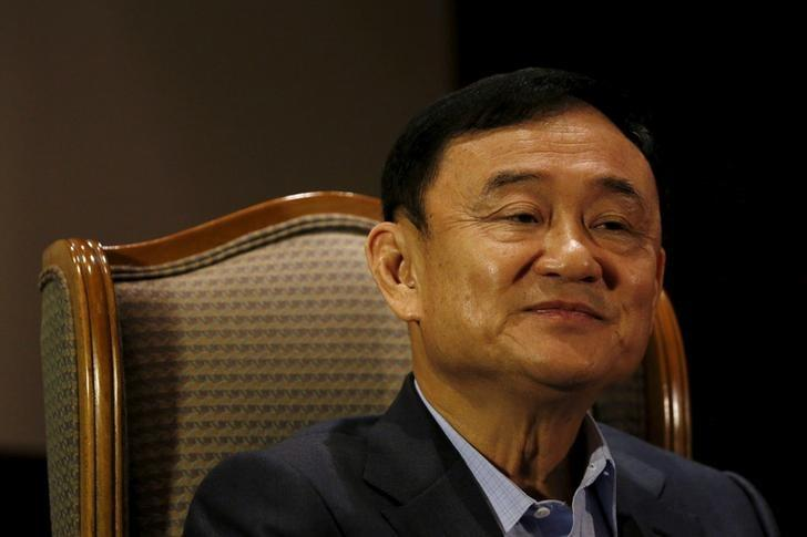 Former Thai Prime Minister Thaksin Shinawatra looks on as he speaks to Reuters during an interview in Singapore February 23, 2016.    REUTERS/Edgar Su/File Photo