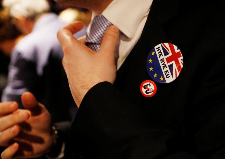 FILE PHOTO: A man adjusts his tie at a Pro-Brexit event to celebrate the invoking of Article 50 after Britain's Prime Minister Theresa May triggered the process by which the United Kingdom will leave the European Union, in London, Britain March 29, 2017. REUTERS/Peter Nicholls