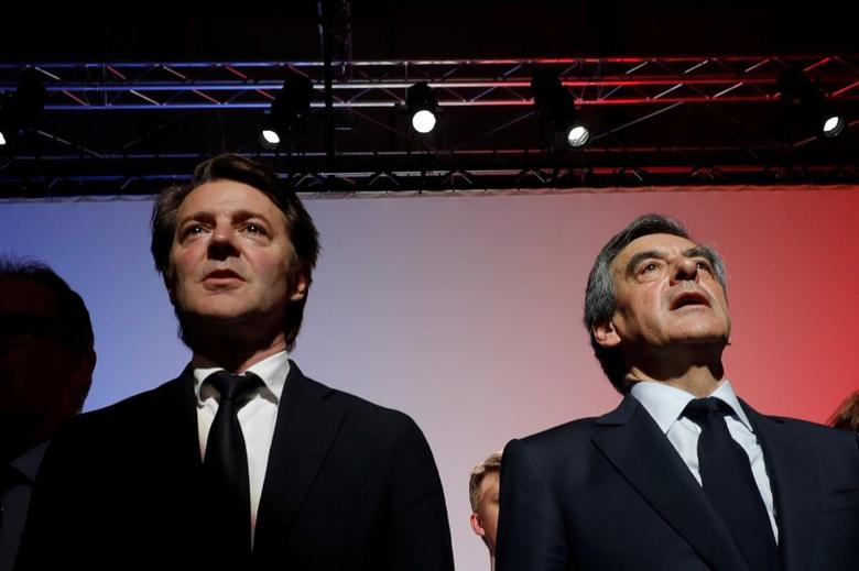 Francois Fillon (R), former French Prime Minister, member of the Republicans political party and 2017 presidential election candidate for the French centre-right and politician Francois Baroin sing the national anthem March 30, 2017 at a campaign rally in Quimper, France. Picture taken March 30, 2017.  REUTERS/Philippe Wojazer