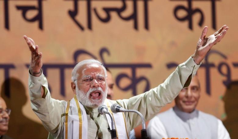 Prime Minister Narendra Modi addresses his supporters at Bharatiya Janata Party (BJP) headquarters in New Delhi, India, March 12, 2017. REUTERS/Adnan Abidi