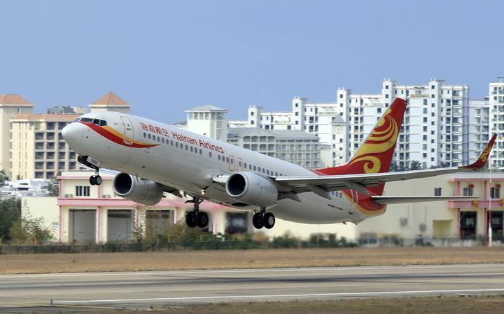 FILE PHOTO: A Hainan Airlines plane takes off from the Sanya Phoenix International Airport in Sanya, Hainan province, China, May 1, 2015. REUTERS/Stringer