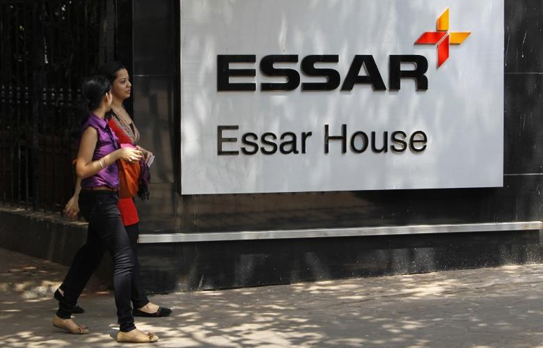 FILE PHOTO: Employees walk past an Essar Group logo outside their headquarters in Mumbai May 20, 2013.  REUTERS/Vivek Prakash