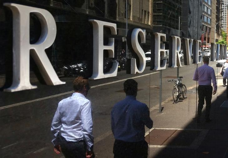 Pedestrians walk past the Reserve Bank of Australia building in central Sydney, Australia, February 10, 2017. REUTERS/Steven Saphore/Files