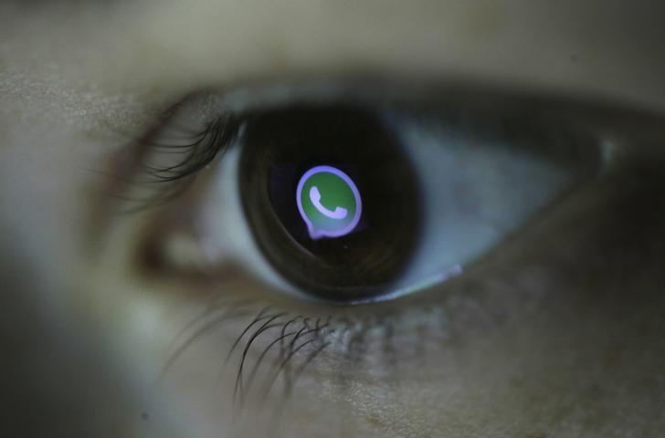 A picture illustration shows Whatsapp's logo reflected in a person's eye, in central Bosnian town of Zenica, March 13, 2015. REUTERS/Dado Ruvic/Files