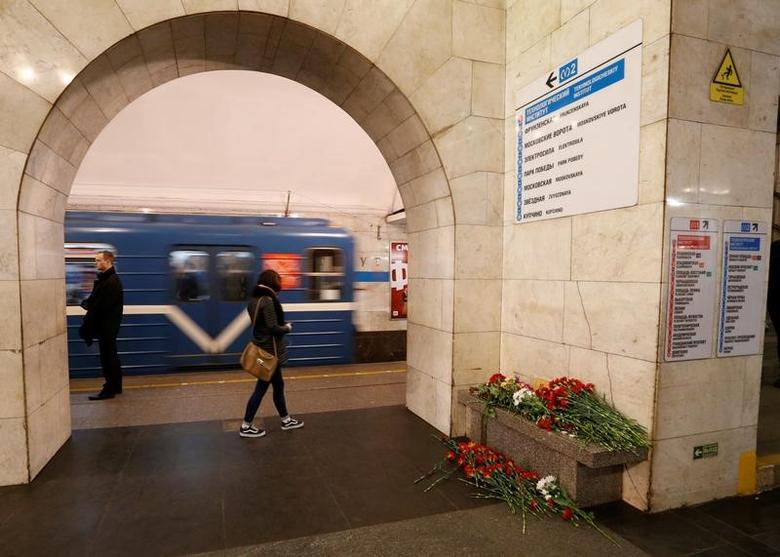 Flowers in memory of victims of a blast in St. Petersburg metro are seen laying at Tekhnologicheskiy institut metro station in St. Petersburg, Russia, April 4, 2017. REUTERS/Grigory Dukor