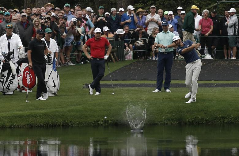 Dustin Johnson of the U.S. skips a ball off the water on the 16th tee during Monday practice rounds for the 2017 Masters at Augusta National Golf Course in Augusta, Georgia. REUTERS/Mike Segar