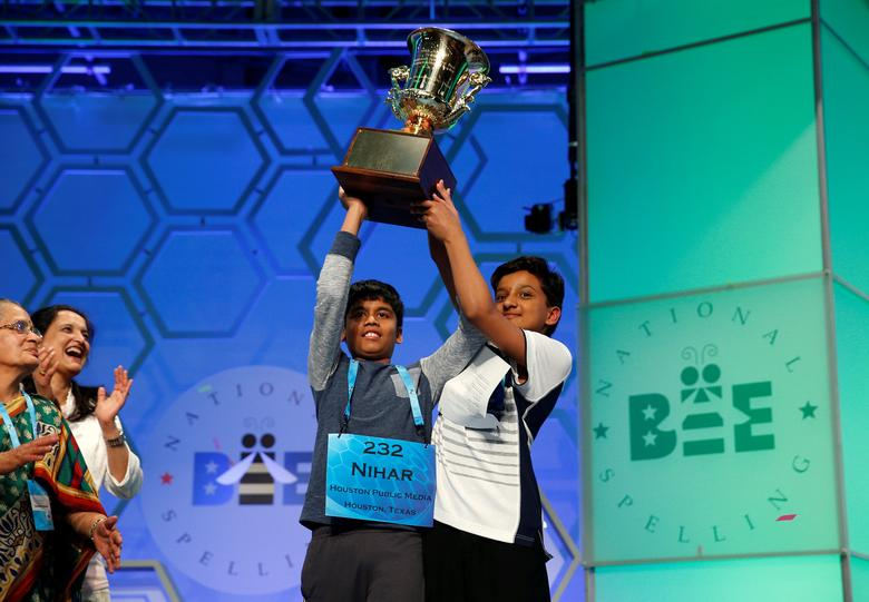 FILE PHOTO -  Co-champions Nihar Saireddy Janga and Jairam Jagadeesh Hathwar (R) hold their trophy upon completion of the final round of Scripps National Spelling Bee at National Harbor in Maryland, U.S. May 26, 2016. REUTERS/Kevin Lamarque/File Photo