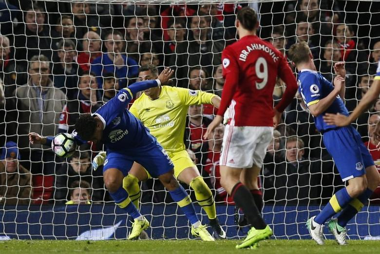 Everton's Ashley Williams handles the ball in the area resulting in a penalty for Manchester United and is later sent off Reuters / Andrew Yates