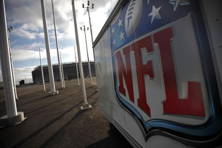 The NFL logo is seen on a trailer parked near the New Meadowlands Stadium where the New York Jets and New York Giants NFL football teams play home games in East Rutherford, New Jersey, March 14, 2011. REUTERS/Mike Segar