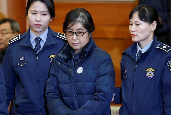 FILE PHOTO: Choi Soon-sil, the woman at the centre of the South Korean political scandal and long-time friend of President Park Geun-hye, arrives for a hearing arguments for South Korean President Park Geun-hye's impeachment trial at the Constitutional Court in Seoul, South Korea, January 16, 2017.  REUTERS/Kim Hong-Ji