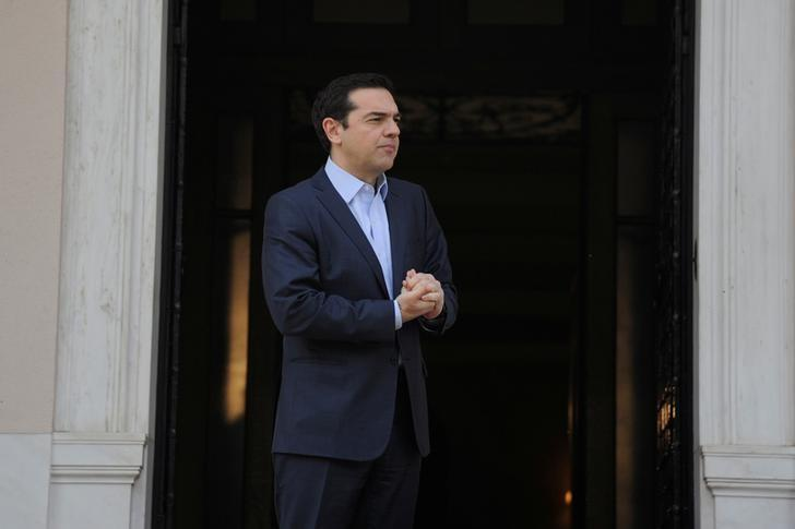 Greek Prime Minister Alexis Tsipras waits to welcome European Council President Donald Tusk at the Maximos Mansion in Athens, Greece, April 5, 2017. REUTERS/Michalis Karagiannis