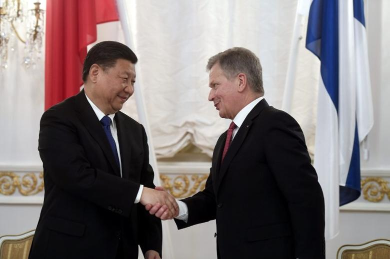 China's President Xi Jinping and Finland's President Sauli Niinisto shake hands during the signing ceremony at the Presidential Palace in Helsinki, Finland April 5, 2017. Lehtikuva/Vesa Moilanen/via REUTERS