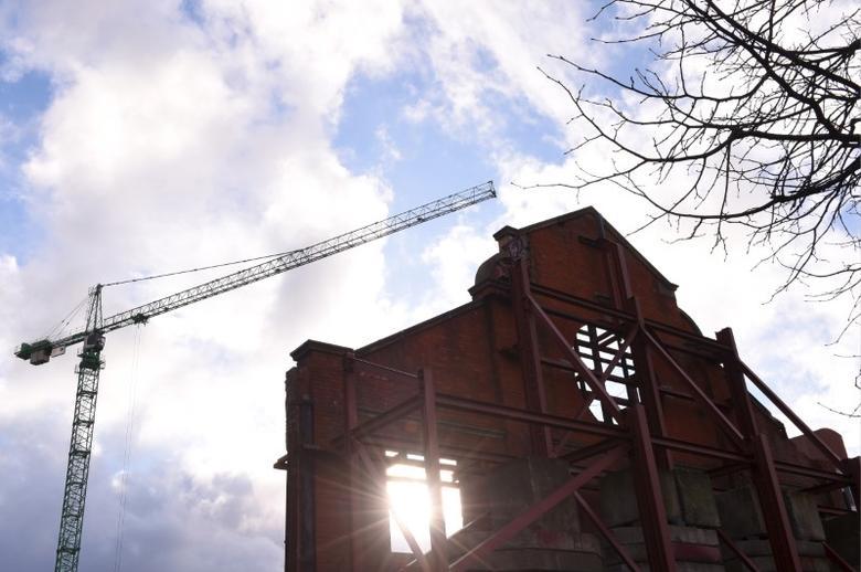 A crane towers over a building site, in Dublin, Ireland February 11, 2016. REUTERS/Clodagh Kilcoyne
