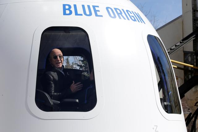 Amazon and Blue Origin founder Jeff Bezos addresses the media about the New Shepard rocket booster and Crew Capsule mockup at the 33rd Space Symposium in Colorado Springs, Colorado, United States April 5, 2017.  REUTERS/Isaiah J. Downing