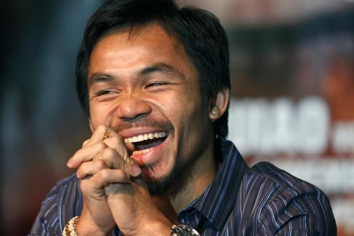 Manny Pacquiao of the Philippines laughs during a news conference at the MGM Grand hotel-casino in Las Vegas, Nevada November 11, 2009.  REUTERS/Las Vegas Sun/Steve Marcus/Files