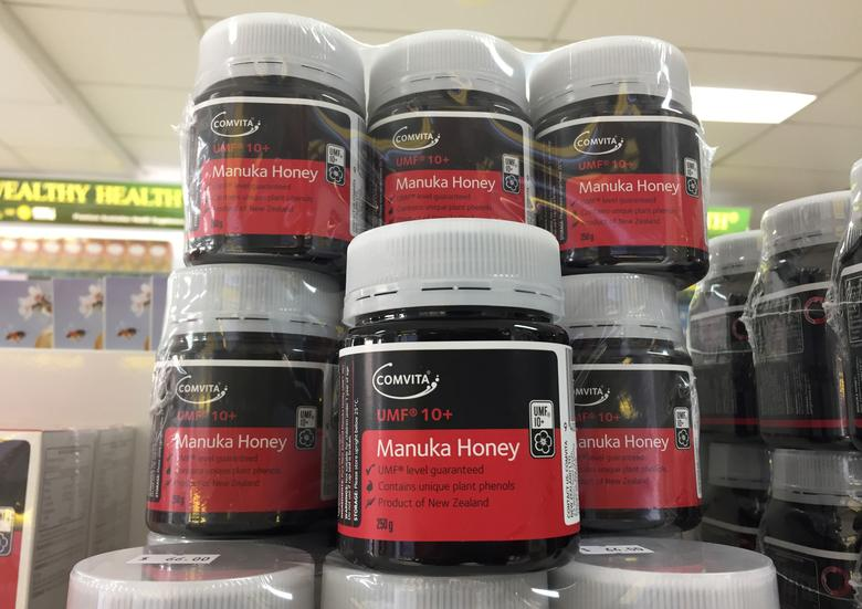 Jars of Comvita brand Manuka honey from New Zealand are photographed on the shelves of a health food store in Sydney, Australia, April 6, 2017.   REUTERS/Jason Reed