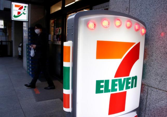 A man walks out of Seven & i Holdings Co's Seven Eleven store in Tokyo. REUTERS/Kim Kyung-Hoon