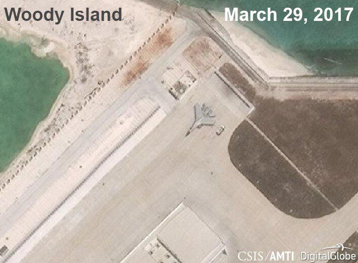 A Chinese J-11 fighter jet is pictured on the airstrip at Woody Island in the South China Sea in this March 29, 2017 handout satellite photo.   CSIS Asia Maritime Transparency Initiative/DigitalGlobe/Handout via REUTERS