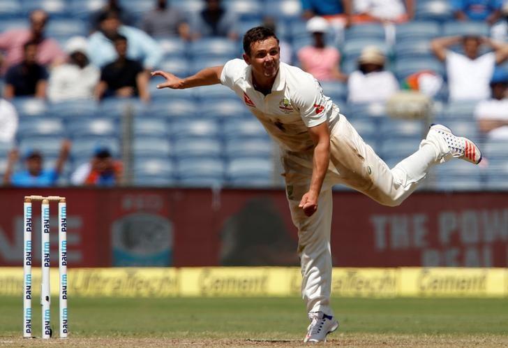Cricket - India v Australia - First Test cricket match - Maharashtra Cricket Association Stadium, Pune, India - 25/02/17. Australia's Steve O'Keefe celebrates the wicket of India's captain Virat Kohli. REUTERS/Danish Siddiqui