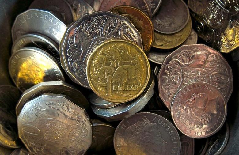 An Australian one dollar coin can be seen amongst various other Australian coins at a store in Sydney, Australia, February 11, 2016.  REUTERS/David Gray