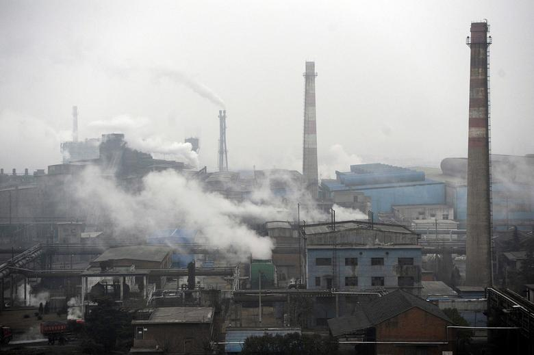 FILE PHOTO: Smoke billows from a coking factory in Hefei, Anhui province March 2, 2012.   REUTERS/Stringer/File Photo